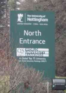 """Photo: A large green sign has as its main text """"North Entrance"""". Above that, it says """"University of Nottingham"""", with a logo of a castle. Below the main text is some more text: World University Rankings, A global Top 75 University."""