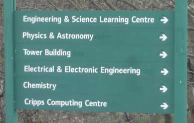 Photo: a green sign lists destinations. All of them have arrows to the right. The different destinations are: Engineering & Science Learning Centre; Physics & Astronomy; Tower Building; Electrical & Electronic Engineering; Chemistry; Cripps Computing Centre.