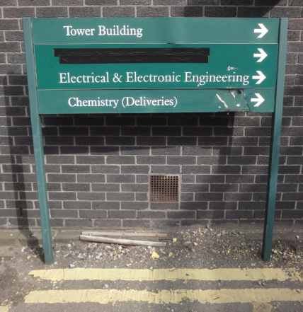Photo: A green sign lists three destinations. All have arrows pointing to the right. The destinations are: Tower Buildling; Electrical & Electronic Engineering; Chemistry (Deliveries).